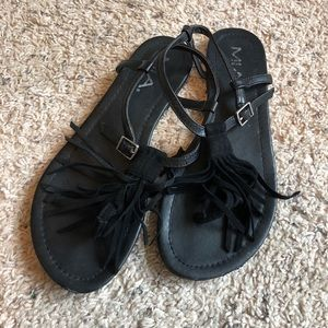 Black sandals with tassels